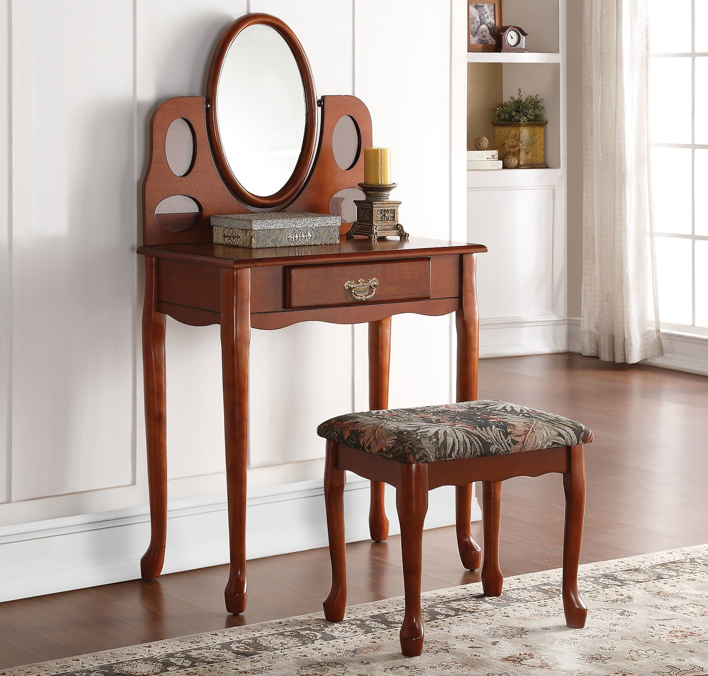 The Aldine Vanity Set will Simply be a functional and stylish addition to any bedroom. Handsomely Crafted in warm Oak Finish, and composed from selected wood and veneers. The vanity desk features: a storage drawer, Tilt Oval Mirror, and is beautifully complemented with a padded seat ottoman. Some Assembly Required