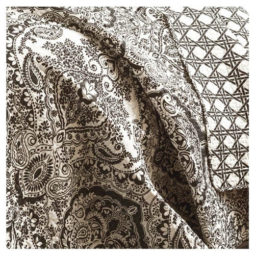 A very traditional damask and paisley pattern highlights this 3-Piece Quilt Set 100-Percent Cotton in Black White Damask. The reverse side utilizes a geometric technique, so if you are looking for your room to have more of a contemporary feel this is the side to use. Either way it's oh so soft and feels great around you! Photo of pattern detail.