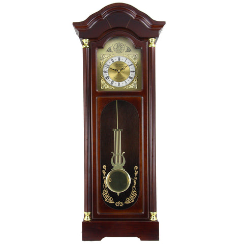 Cherry colored wood pendulum clock with brass face and pendulum.