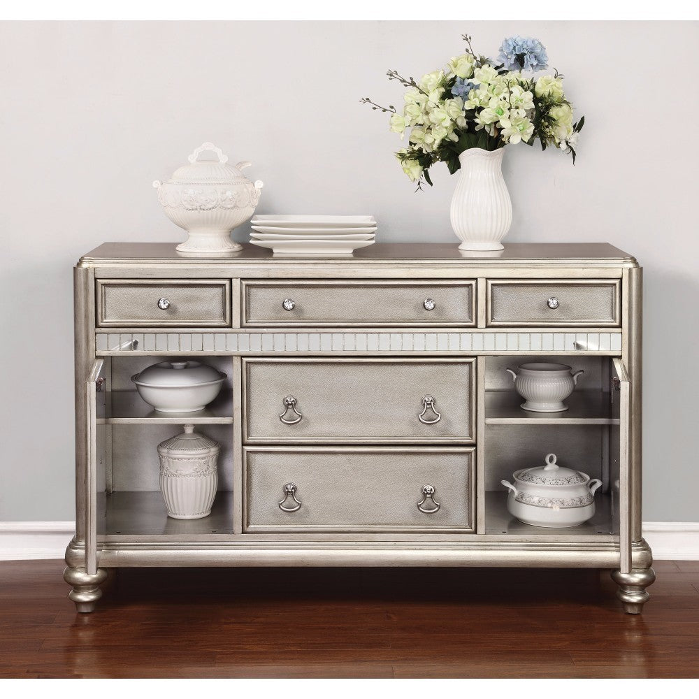 Elegant Platinum finish dining room sideboard. silver color with 5 drawers with silver pulls.