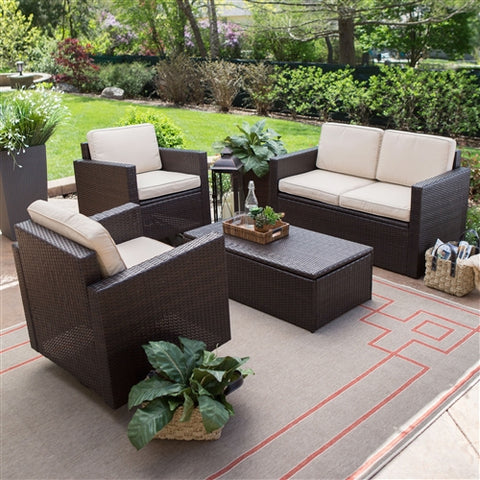 Brown 4 piece wicker furniture set on an outdoor patio.