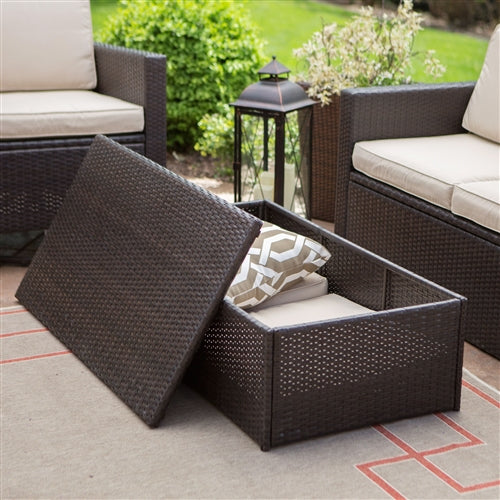 Detail of how the brown wicker coffee table opens to provide storage space.
