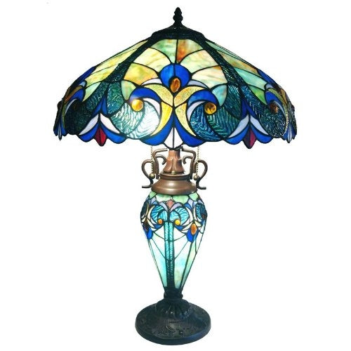 Mulitcolored Tiffany style lamp with glass shade and base.