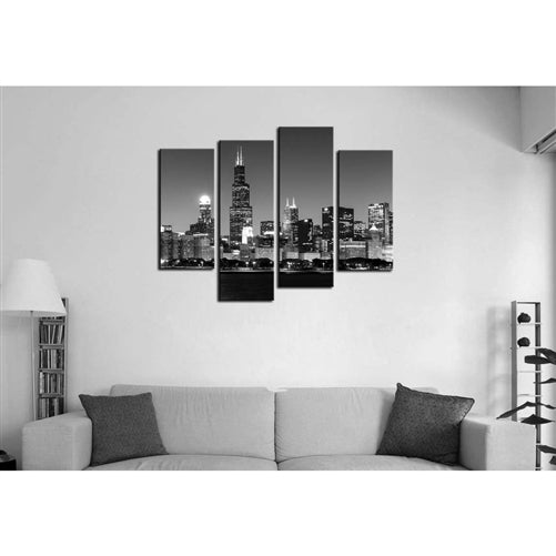black and white living room setting with a black and white wall art of the chicago skyline on the wall.