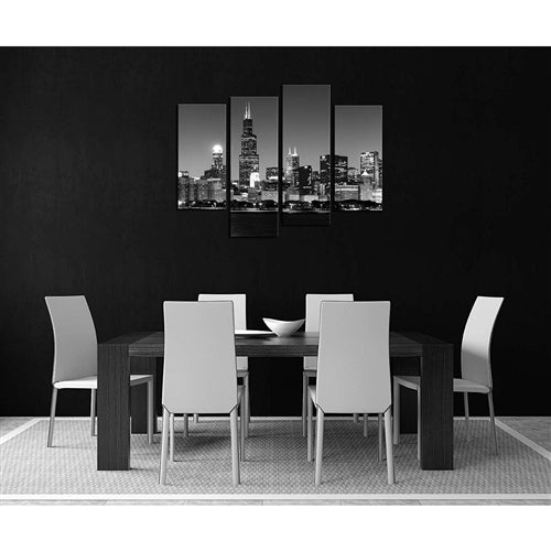black and white dining room setting with a black and white chicago skyline painting on the wall.