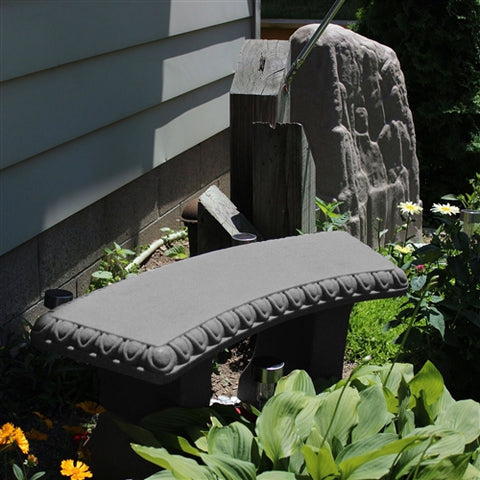 gray granite resin garden bench in an outdoor setting.