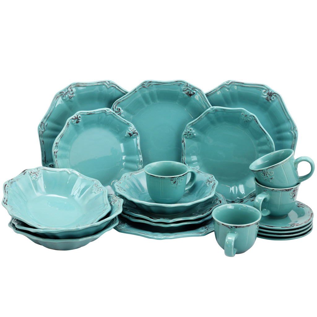 Turquoise dinnerware set on a white background.