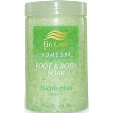 Clear container of green dead sea bath salts