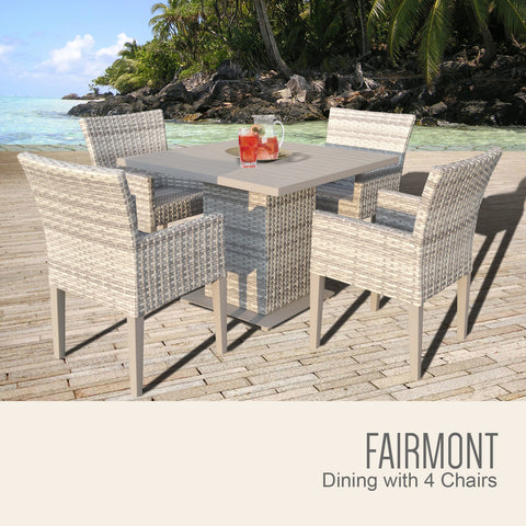 light colored wicker table with four chairs along side an island scene.