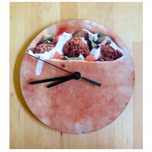 wall clock which looks like a felafel with bread pocket full of veggies.