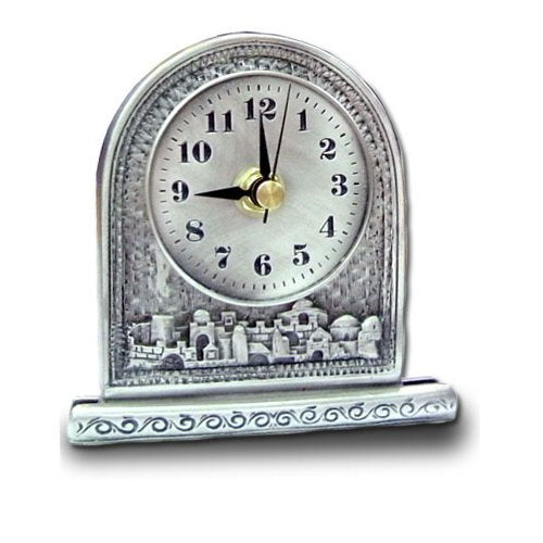 silver colored desk clock with white face and black numbers and a artistic view of the city of Jerusalem.