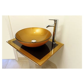 Left facing view of a glass golden sink bowl with a spout faucet