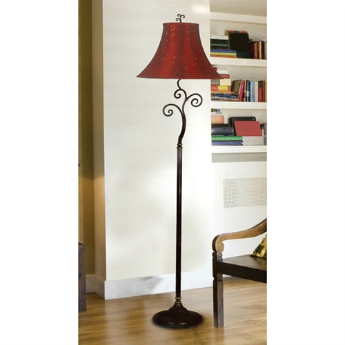 A floor lamp with a red and gold shade in a living room environment in natural daylight.