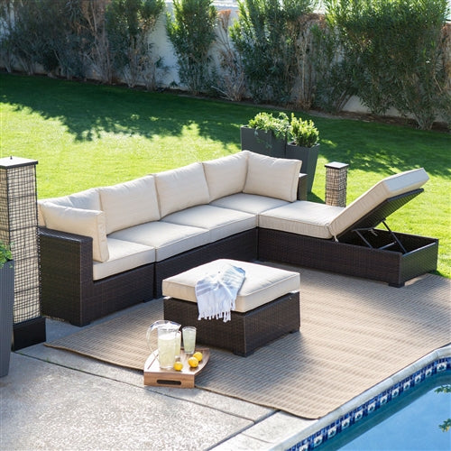 sectional wicker patio set with access to storage areas highlighted.