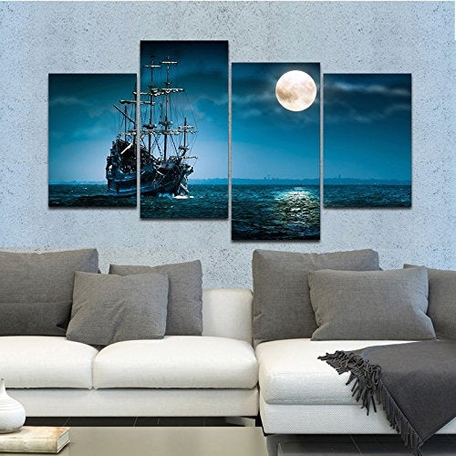 living room scene white couch with gray pillows and blue painting on the wall behind of a ship in the  moonlight.
