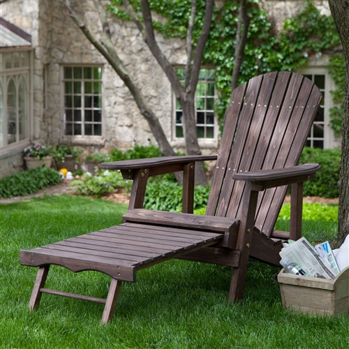 Brown wood Adirondack chair in an outdoot setting front view.