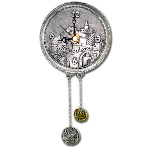 round silver clock with the old city of Jerusalem on the face and two hanging chains with a windmil and menorah on round coin shaped chain ends.