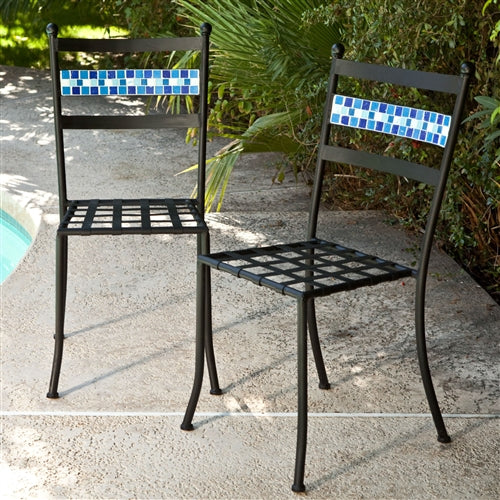 2 black chairs with blue terracotta tile backs in an outdoor setting.