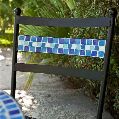 detail of light blue and dark blue terracotta tiles in a black chair.