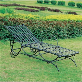 Black metal Chaise Lounge in an outdoor setting no cushion.