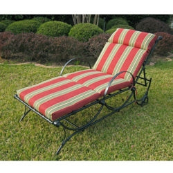 Black metal Chaise Lounge in an outdoor setting with a red and white cushion. Cushion not included.