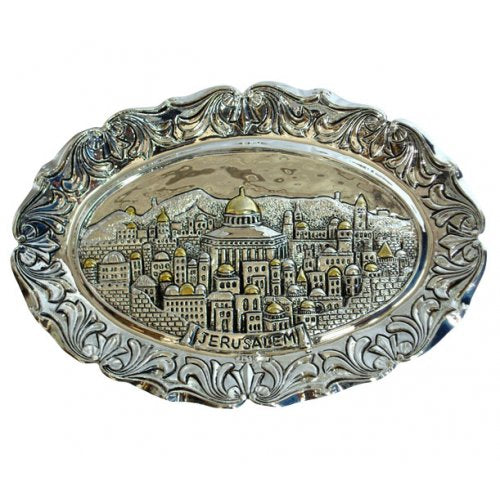 Silver and gold wall plate with the depcition of Jerusalem.