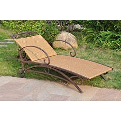 Brown wicker chaise lounge with floral cushions. cushions not included.