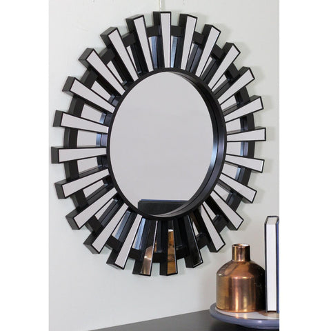 Photo of mirror in real life setting. This beautifully crafted mirror will add a touch of modern elegance to any room in your home Features a round black frame with mini mirrored columns inspired by a shimmering sunburst ! Can be hung vertically or horizontally Includes hanging hardware.