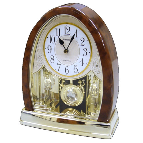 wooden and silver and brass pendulum mantle clock