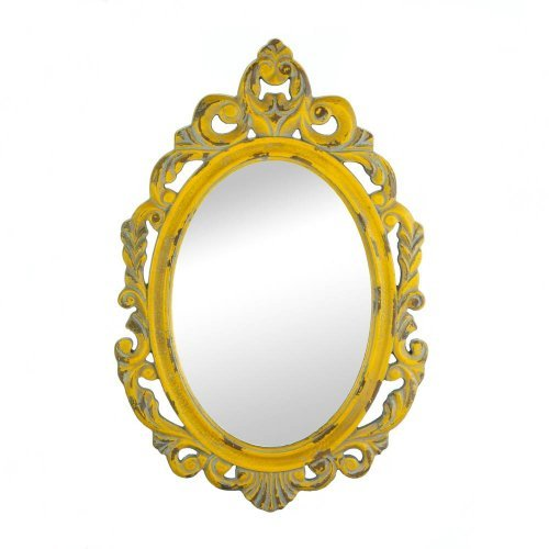 Give your room a regal dose of style Simply by adding this weathered yellow wall mirror to any room! Made to look like a timeworn treasure, the ornately carved wooden frame will brighten your space while adding to its allure! The color of this item may vary due to distressed finished.