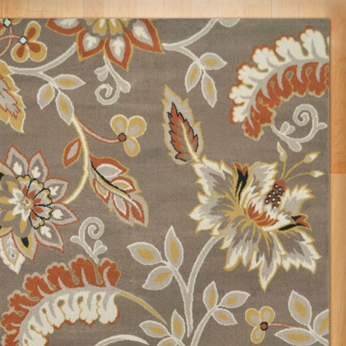 "Photo of rug detail. Warm up any room with the orange and yellow accents of this 5'2"" x 7'2"" Tufted Cotton Area Rug Neutral Beige Yellow Orange Floral Pattern. Flowing florals are set against a neutral backdrop to create a stylish scene for your entryway, living room, or dining room. Woven from cotton, this rug is soft and offers fuss-free maintenance."