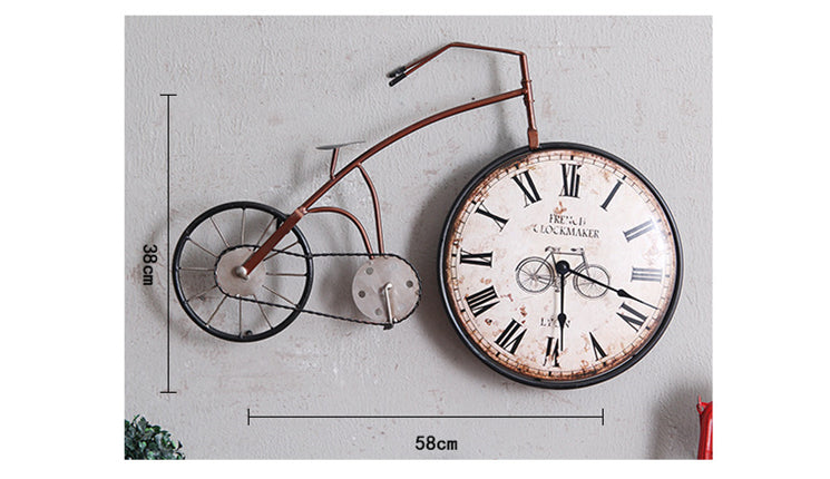 red oldstyle bicycle wall clock with clock in the front wheel.