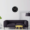 Black wall clock in a living room