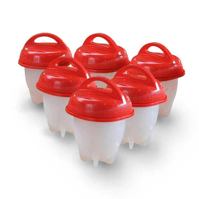 Six white egglettes with red lids lined up like bowling pins for display.