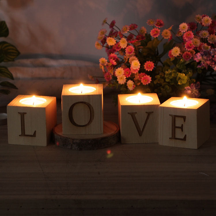 Add Love to any room with this 4 piece set of tealight wooden candle holders that spell LOVE.  Simple but stylish, these wooden candle holders will be a great accent to sit on top of your fireplace mantle, bedroom dresser, kitchen counter or bathroom shelf.  Since they are made from wood, some irregularities in wood grain are expected, which adds to the country charm of this set!  Actual setting with candles lit in the dark.