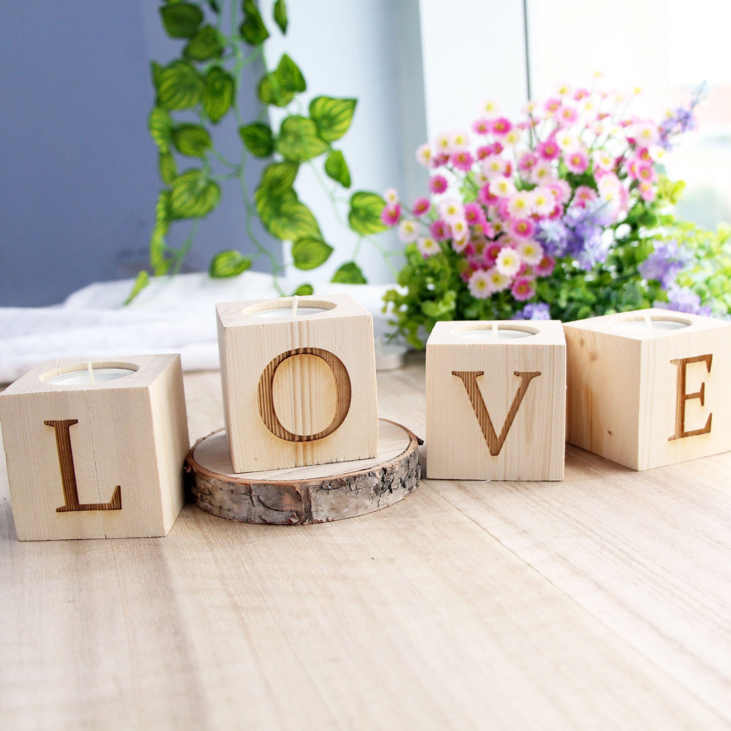 Add Love to any room with this 4 piece set of tealight wooden candle holders that spell LOVE.  Simple but stylish, these wooden candle holders will be a great accent to sit on top of your fireplace mantle, bedroom dresser, kitchen counter or bathroom shelf.  Since they are made from wood, some irregularities in wood grain are expected, which adds to the country charm of this set!