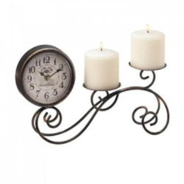 metal scrollwork table clock with two candle holder teiered up from the clock