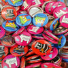 assortment of colorful pins buttons