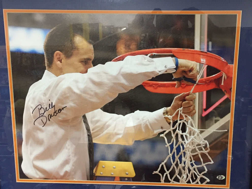 This is a autographed picture of Billy Donovan cutting the net off a hoop. The picture is framed and matted. This is a must have for any Billy Donovan fan.
