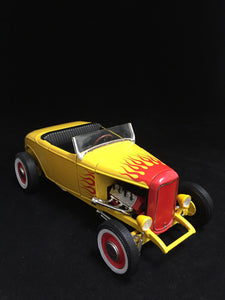 You are looking at at a replica 1932 Ford street rod made by Ertl. The body color is an exclusive yellow with red flames. Has black interior and no roof. Doors and hood open along with steerable front wheels. Condition of the car is new out of box with no scratches or blemishes on paint.