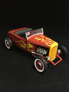 You are looking at a replica 1932 Ford Highboy made by Ertl. Body color is an exclusive red with yellow flames. Black detailed interior along with doors and a hood that open. Steerable front wheels. Condition of the car is new out of box with no scratches or blemishes on paint. Bumpers and windshields intact.