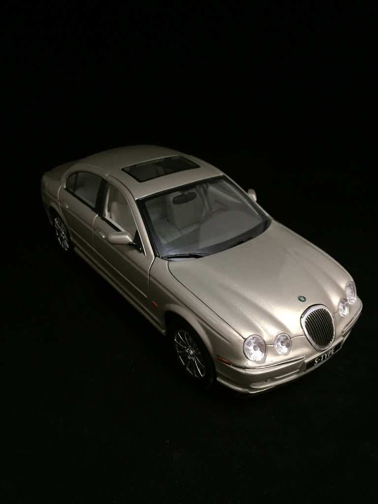 You are looking at a replicat 1999 Jaguar S-Type made by Maisto. Body color is light gold or beige. Gray interior with doors, trunk and hood that open. Steerable front wheels. Condition of the car is near perfect as the windshield has a small scratch but NO blemishes on body paint.