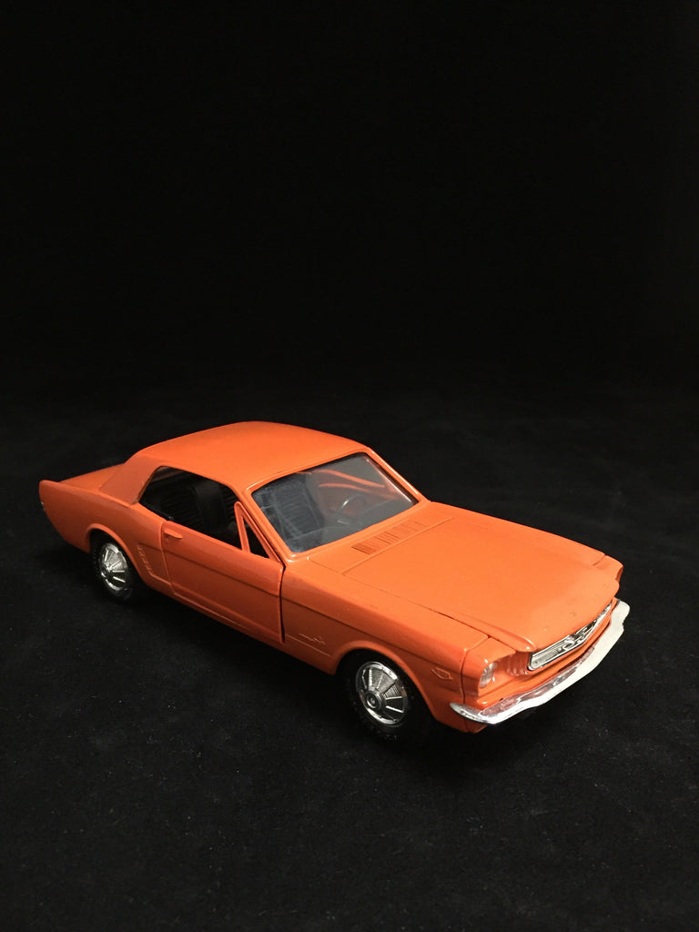 You are looking at an orange 1:24 scale diecast replica of a 1965 Mustang car. This car has opening doors and hood. The front wheels cannot be steered. It has black interior. Condition of the car is Fair. The back wheels cannot fully spin, some blemishes on hood and left side of the body. bumpers lights and grill are all in great shape.