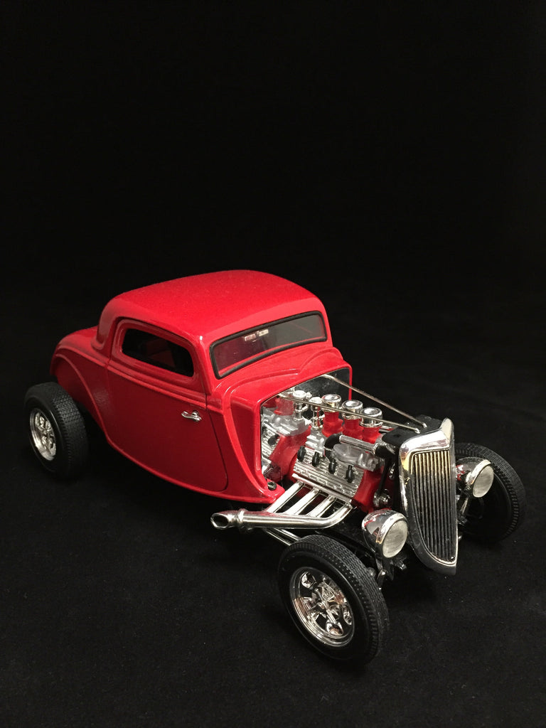 You are looking at a replica 1934 Ford coupe hot rod made by ertl collectibles. The body color is red with black and red interior. Doors open and front wheels are steerable. Open engine concept. Condition of the car is new with no blemishes or broken parts.