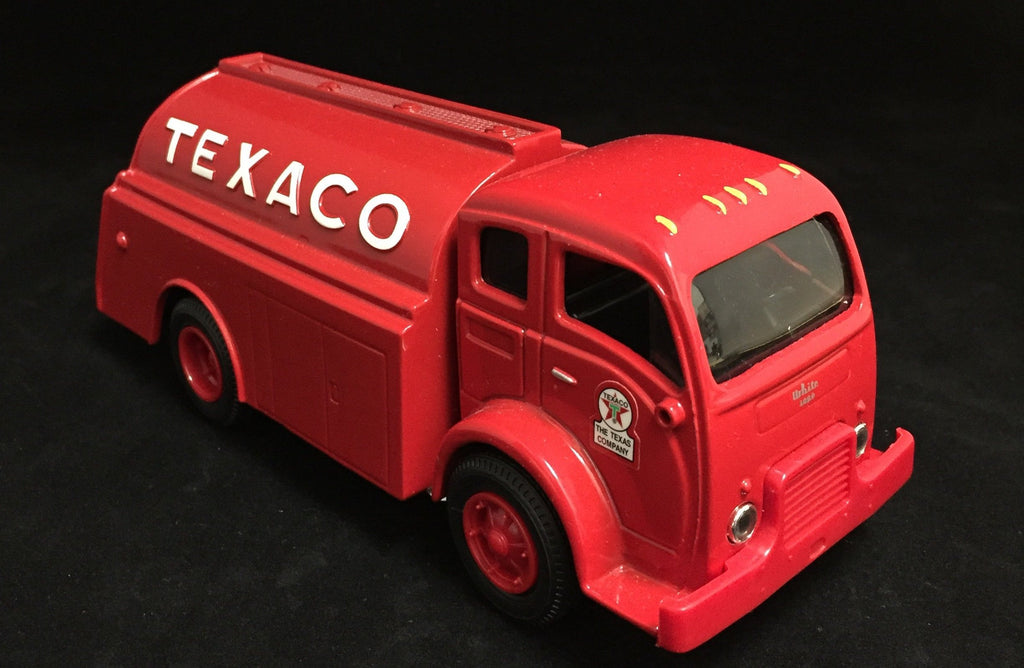 You are looking at a replica 1949 texaco tanker coin bank. This tanker has a red body with black interior. Tanker is in new condition. The wheels spin without stick.  This is a coin bank and comes with a key that will open the bottom to release what change has been stored up. Coins are deposited thru a coin slip on the back ed of the tanker.