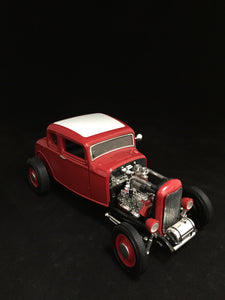 You are looking at replica 1932 ford coupe hot rod made by Ertl. Body color is red with a white roof. Black interior with doors that open and steerable front wheels. Condition of this car is fair. paint is starting to crack on the white roof along with cracking paint of the left head light. The rest of the car is in perfect condition with spinning wheels and no missing parts.