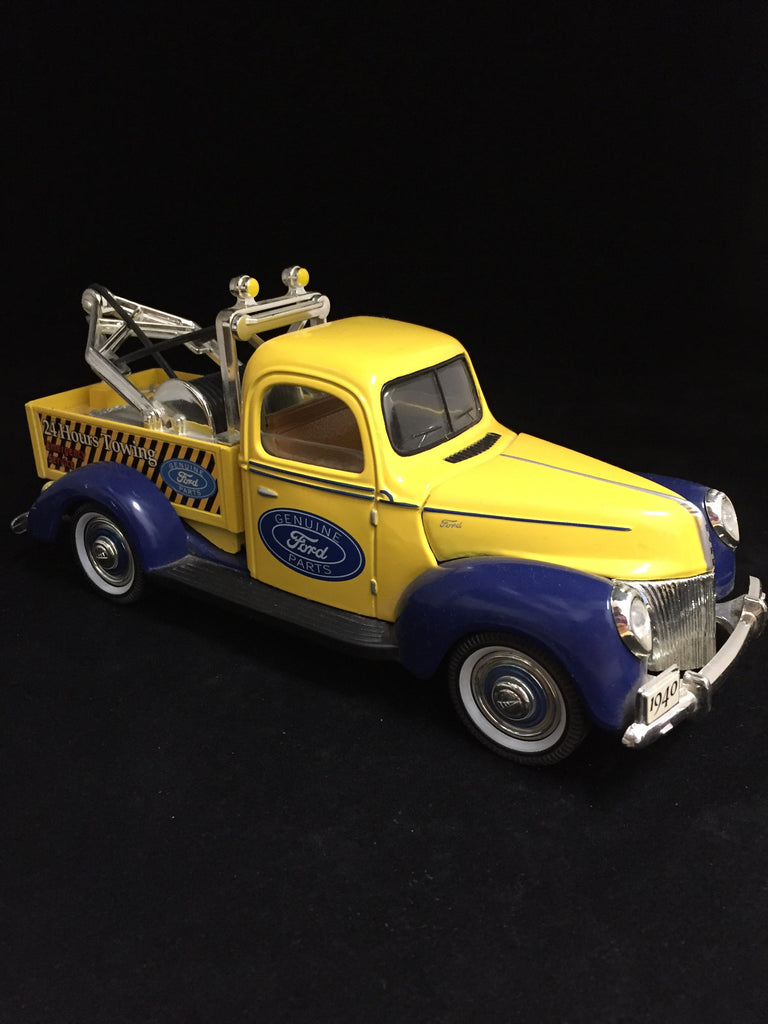 You are looking at a replica 1940 Ford Tow Truck made by Golden Wheels. The body color is yellow with blue fenders.Only working feature is a opening hood. Condition of the truck is near perfect. The back right fender has 2 small blemishes on the paint. Front bumper does have a crack underneath the truck where you cannot see it, it does not affect appearance of bumper.