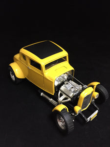 "You are looking at a replica 1932 Ford coupe hot rod made by Ertl. Body color is yellow with a black roof. Front wheels are steerable and doors do open. This cars condition is near perfect with on paint blemish on the trunk. Open engine style. Has a california license plate on front and back reading ""THX 138""."