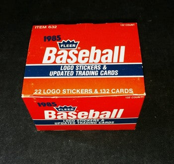1985 complete set of 132 Fleer Updated  trading cards. Has players Ozzie Guillen and  Rickey Henderson. Comes with 22 Stickers and 132 cards. Box has some wear to it.