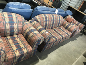 Peach patterned 2 seater couch with 2 chairs